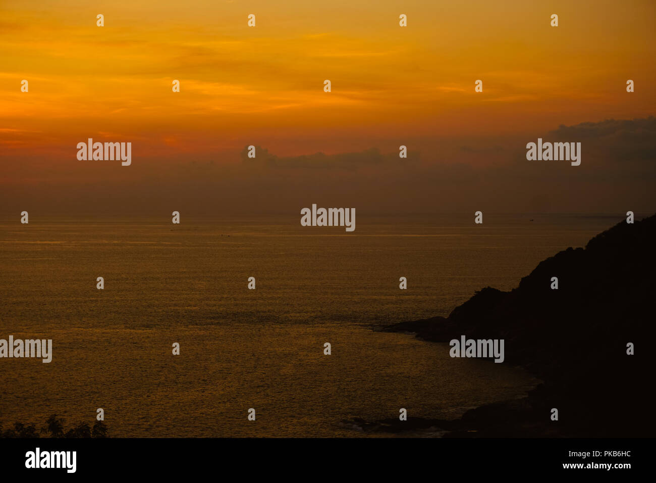 Amazing orange sky, calm sunset skyscape and sea. - Stock Image