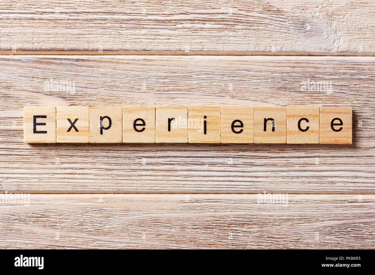experience word written on wood block. experience text on table, concept. - Stock Image