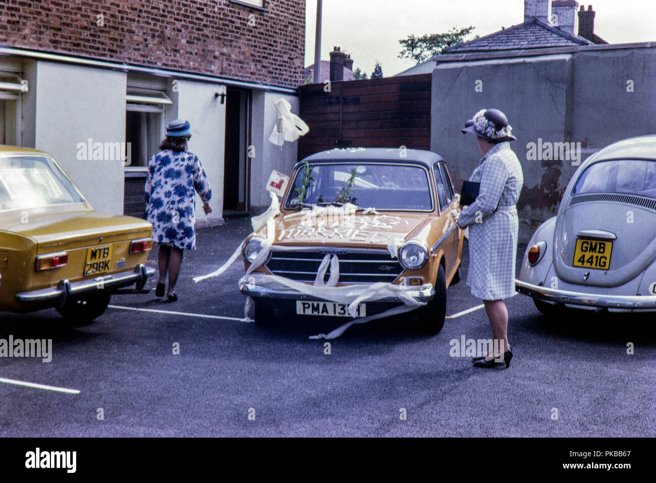 Austin 1300 GT covered in 'Just Married' wedding celebrations August 1972 - Stock Image