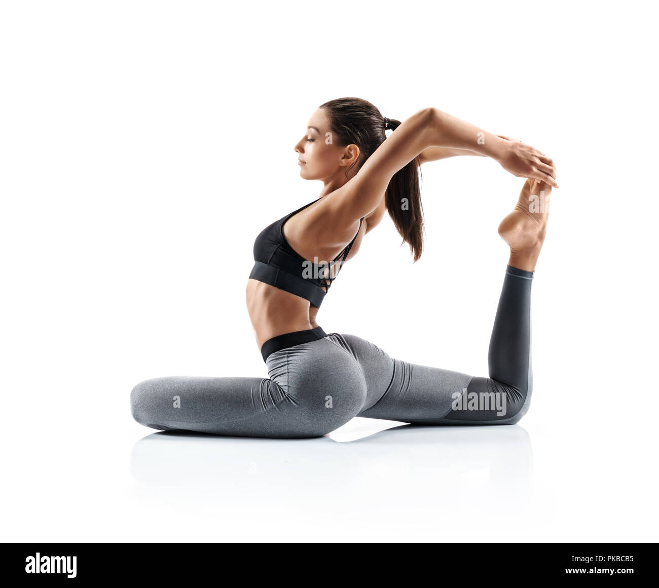 Sporty Young Woman Doing Yoga Practice Isolated On White Background Concept Of Healthy Life And Natural Balance Between Body And Mental Development Stock Photo Alamy