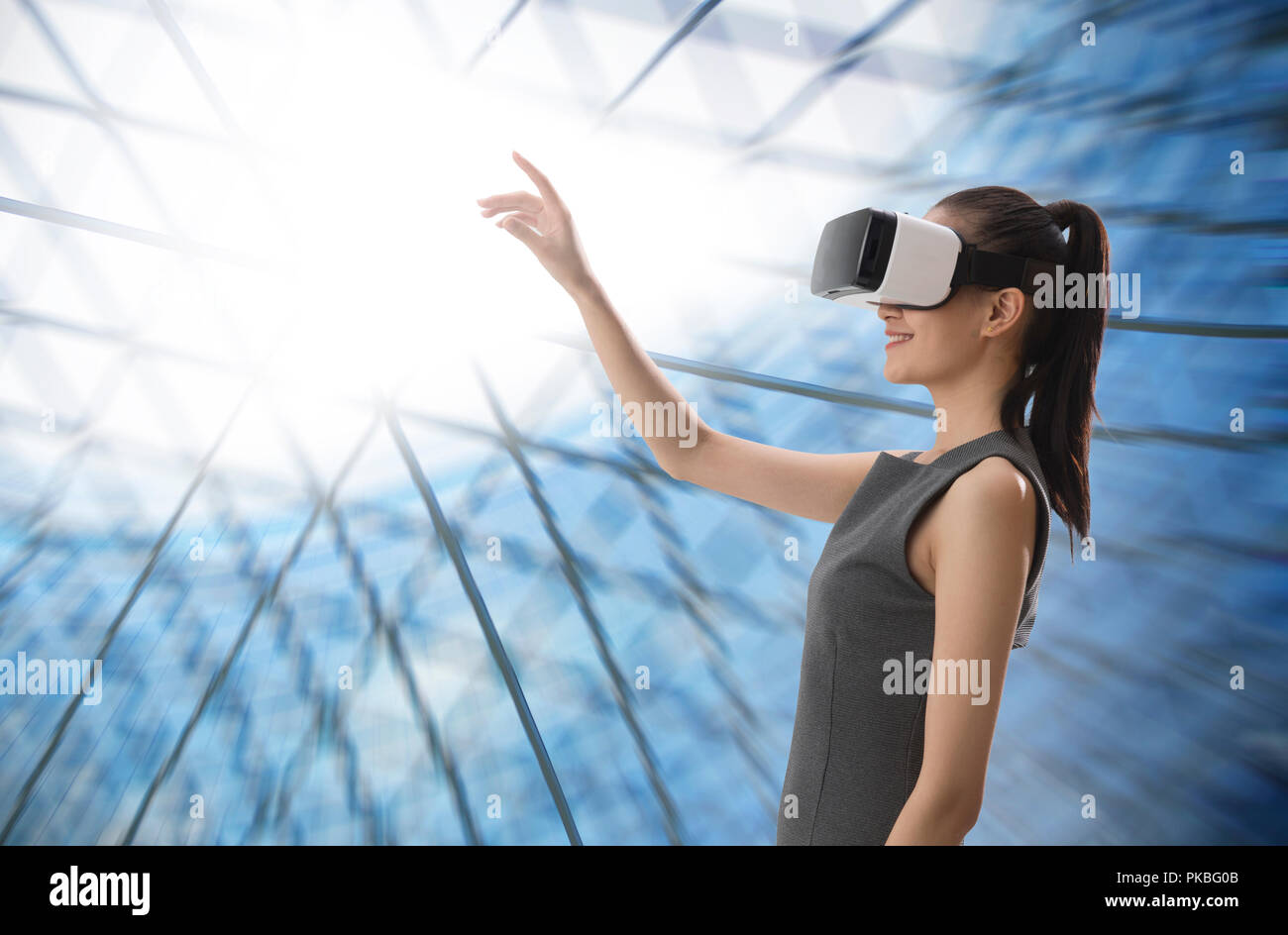 VR glasses young woman - Stock Image