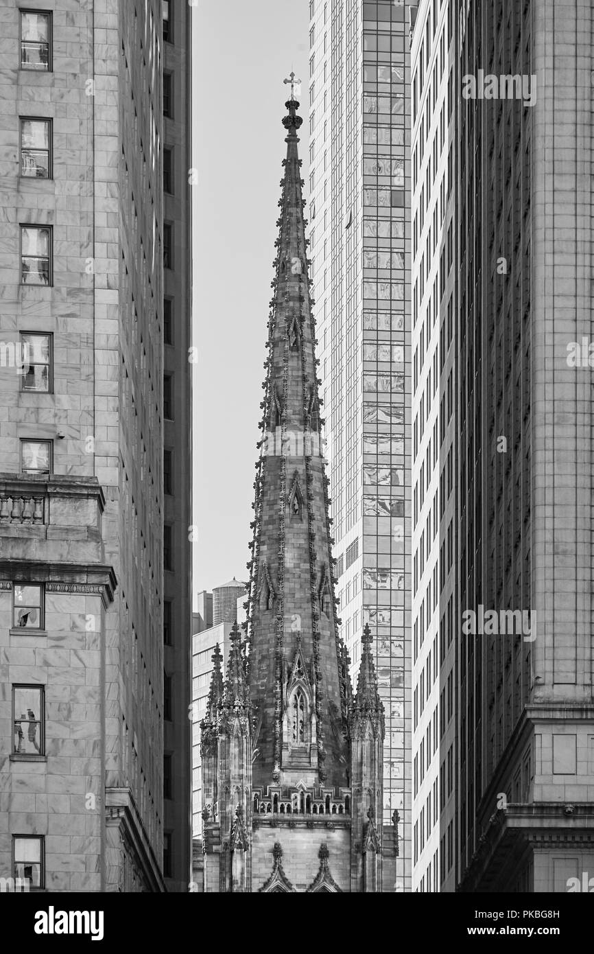 Trinity Church tower between skyscrapers, New York City, USA. - Stock Image