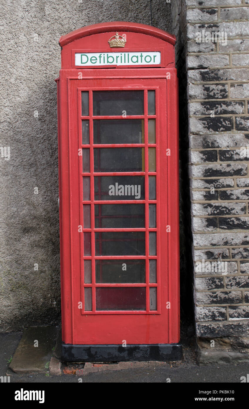 Defibrillator Uk in an old fashioned traditional red telephone box now no longer in use for making phone calls but used to keep defibrillators for public use. England 2010s. HOMER SYKES Stock Photo