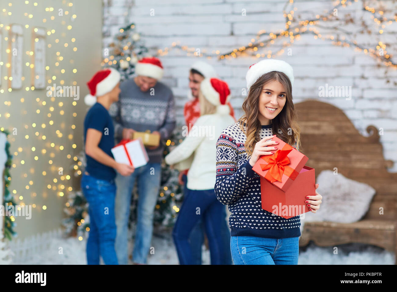a group of friends with gifts at a christmas party