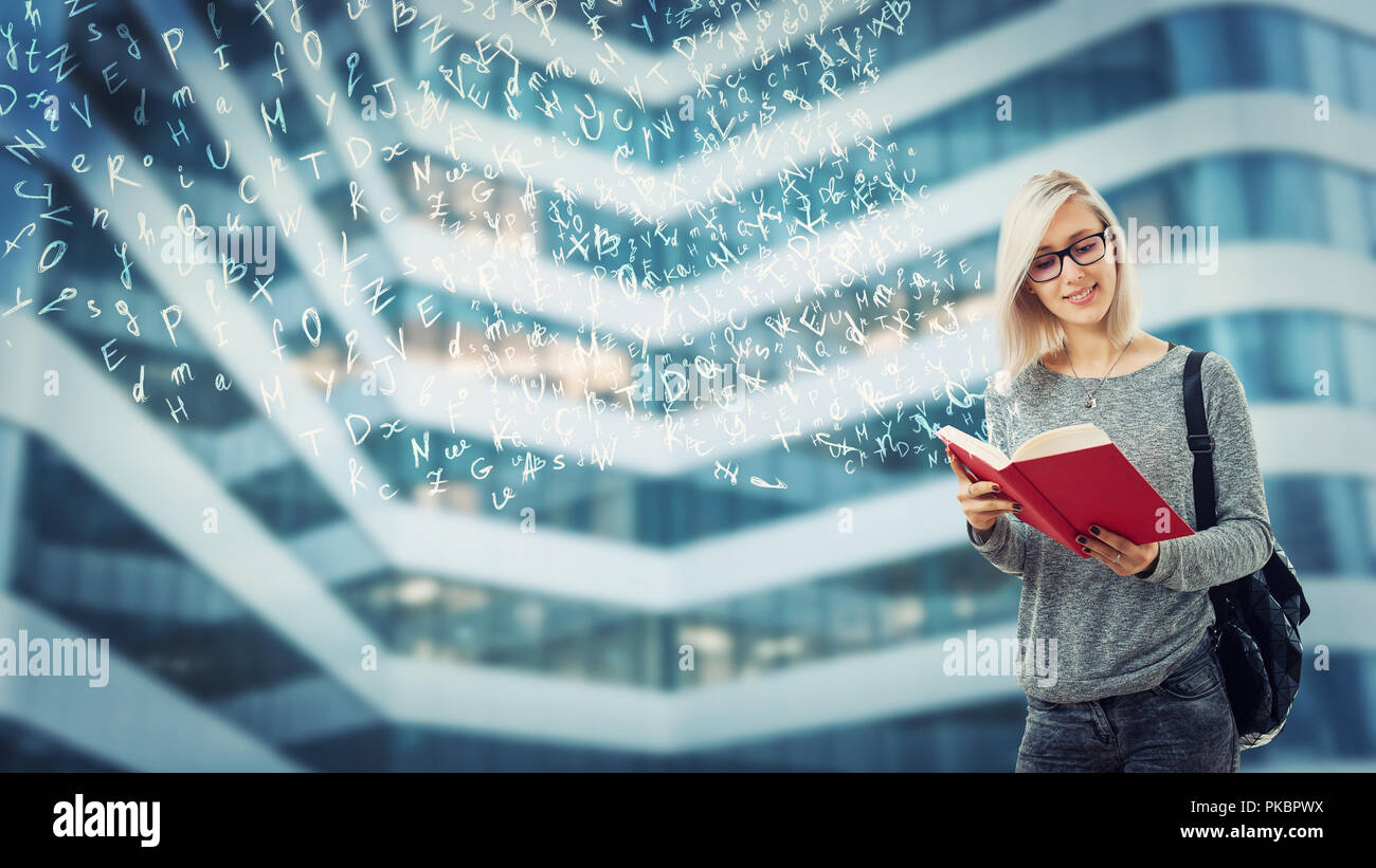 Young student female with a backpack and glasses reading a book imagine flying alphabet letters escape from pages. The magic of literature. Educationa - Stock Image