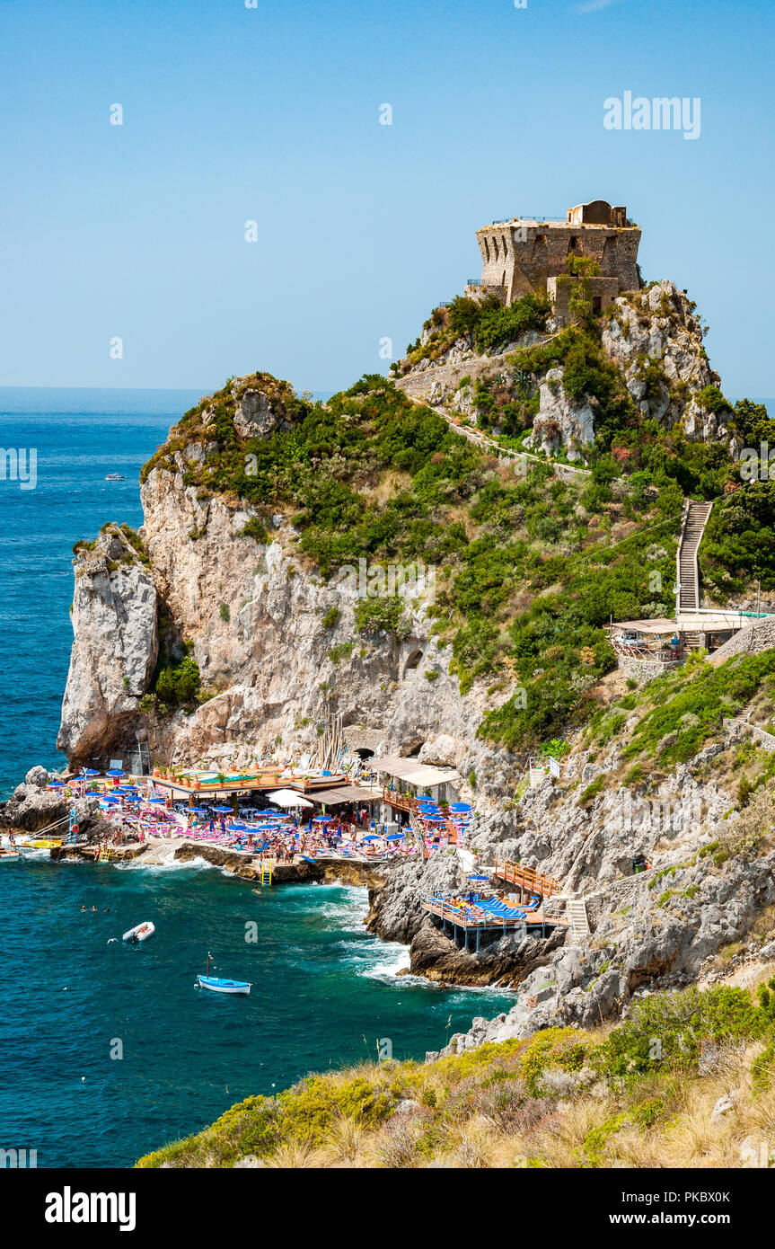 The beach at Capo di Conca on the Mediterranean Sea in Conca dei Marini, Salerno, Campania, Italy - Stock Image
