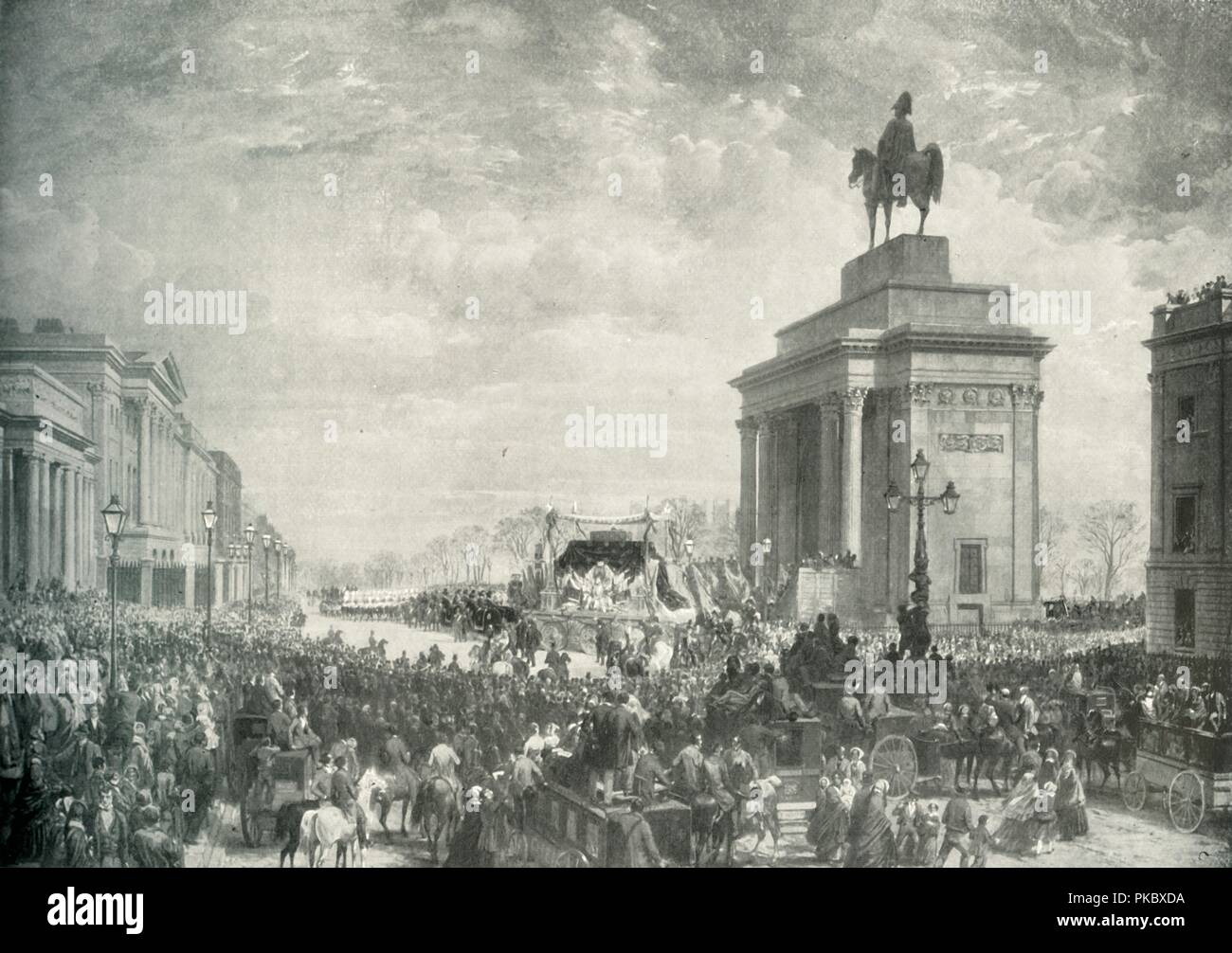 'The Funeral of the Duke of Wellington Passing Apsley House, November 18, 1852', (c1897). Crowds in London for the funeral of soldier and prime minister Arthur Wellesley (1769-1852) the 'Iron Duke' who had been a trusted advisor to Queen Victoria who named her third son after him. On the right is an equestrian statue of him on top of the Wellington Arch. From Sixty Years A Queen: The Story of Her Majesty's Reign, by Sir Herbert Maxwell. [Harmsworth Bros, Limited, London, c1897] - Stock Image