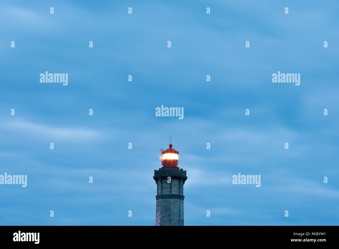 Phare des baleines at night with moody clouds, Ile de ré, France - Stock Image