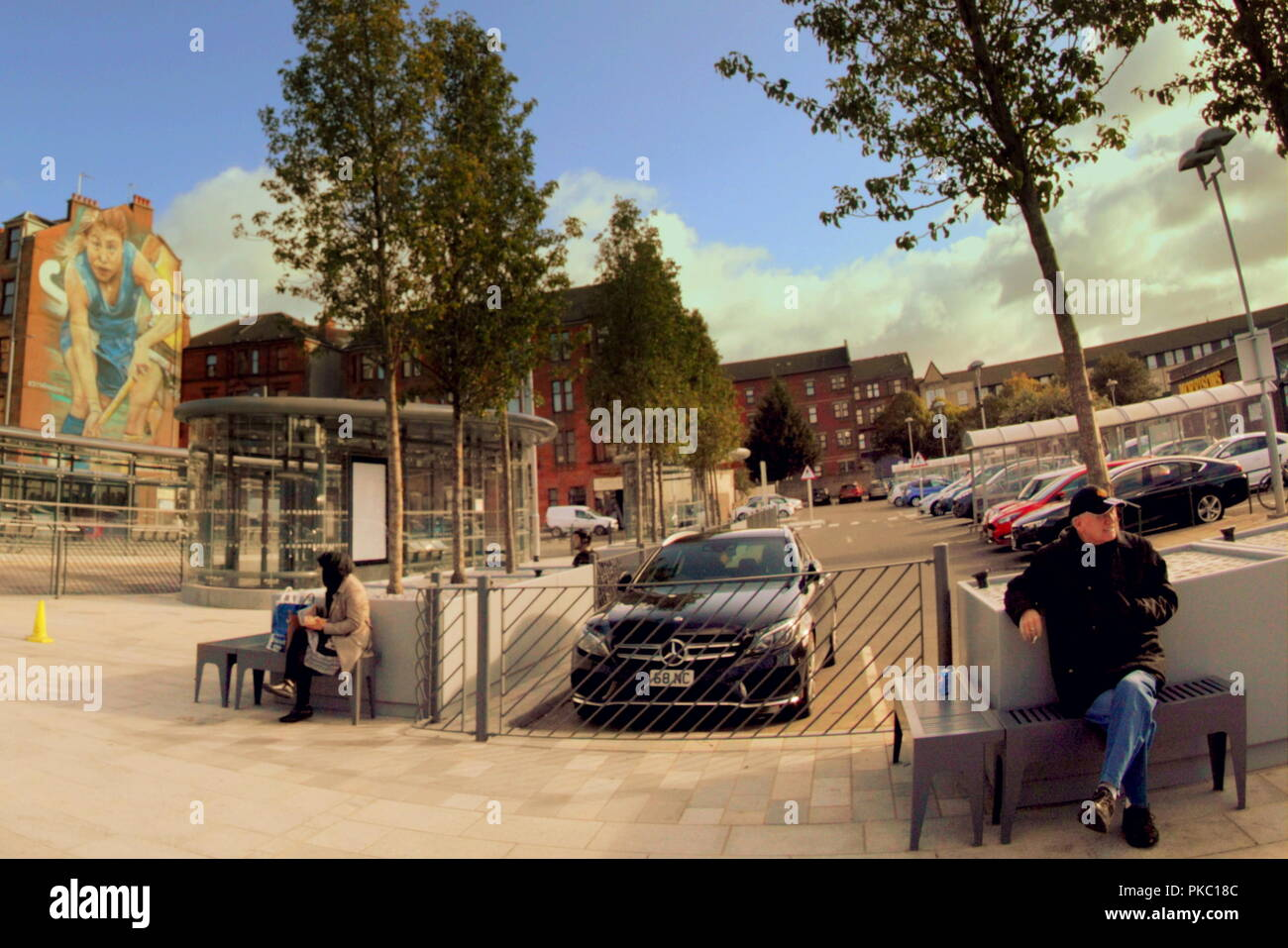 Glasgow, Scotland, UK, 12th September, 2018. UK Weather: Sunny weather on the newly revamped Partick bus station today as locals sit in the sun ahead of stormy weather forecast for later in the month. Credit: gerard ferry/Alamy Live News - Stock Image