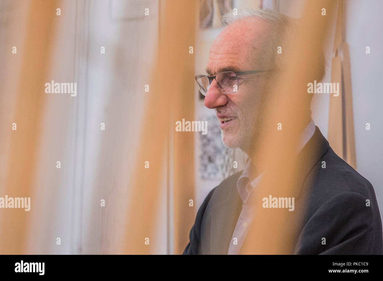 London, UK. 12th Sep, 2018. Renzo Piano behind a model fro the Jerome Seydoux Pathe Foundation - Renzo Piano: The Art of Making Buildings in the Gabrielle Jungels-Winkler Galleries of the Royal Academy of Arts. Piano is an architect and Honorary Royal Academicianand this is the first comprehensive survey of hiss career to be held in London since 1989 - forming part of the 250th anniversary of the Royal Academy. Credit: Guy Bell/Alamy Live News - Stock Image