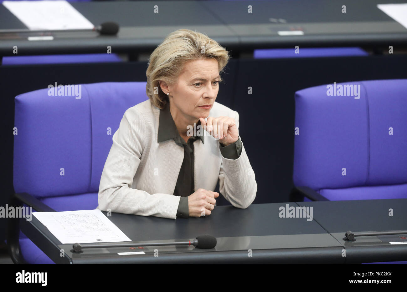 Berlin, Germany. 12th Sep, 2018. Ursula von der Leyen, Federal Minister of Defence (CDU), is following the general debate in the German Bundestag. The main topic of the 48th session of the 19th legislative period is the draft of the Federal Budget 2019 submitted by the Federal Government and the Federal Finance Plan 2018 to 2022 with the general debate on the budget of the Federal Chancellery. Photo: Jörg Carstensen/dpa - Stock Image