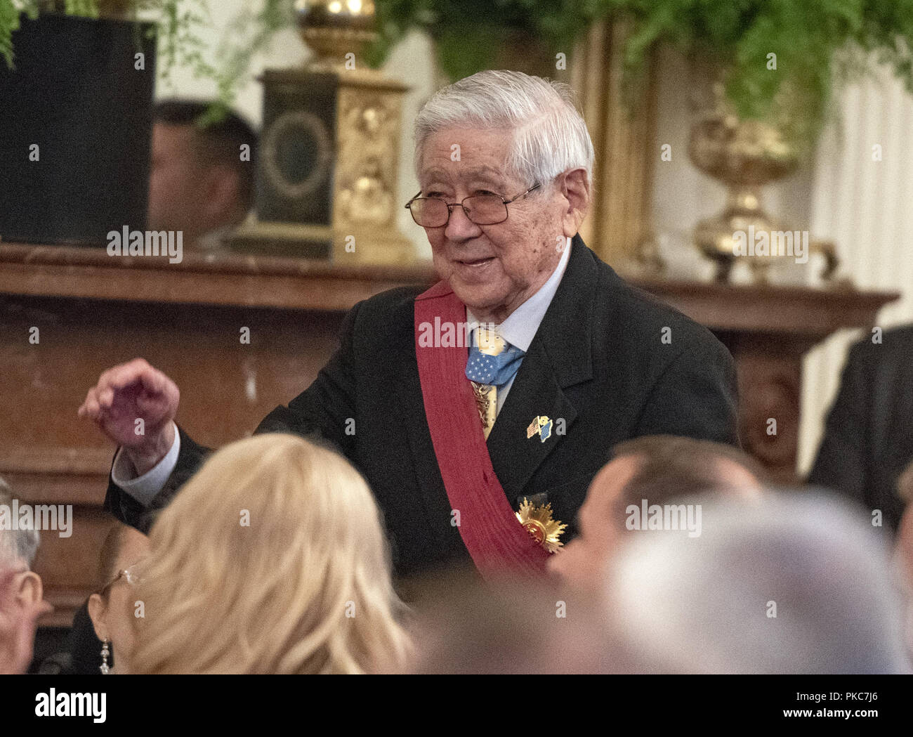 Washington, District of Columbia, USA. 12th Sep, 2018. Then-Staff Sergeant Hiroshi Miyamura, United States Army, a Medal of Honor recipient for bravery in the Korean War, stands after being introduced by US President Donald J. Trump as he makes remarks at the Congressional Medal of Honor Society Reception in the East Room of the White House in Washington, DC on Wednesday, September 12, 2018 Credit: Ron Sachs/CNP/ZUMA Wire/Alamy Live News - Stock Image