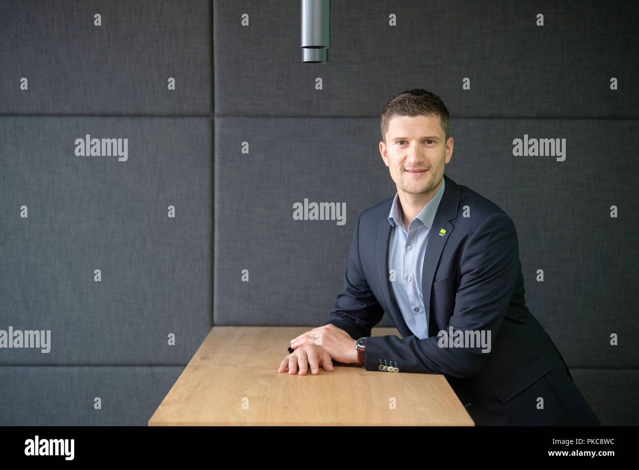 """12 September 2018, Baden-Wuerttemberg, Waeschenbeuren: 12 September 2018, Germany, Waeschenbeuren: Manuel Nader, head of the German headquarters of the smart home provider Loxone, is standing at a table. Loxone settled in Waeschenbeuren east of Stuttgart some time ago and relies on self-contained complete systems that can control various electronic components in a building. (on dpa """"Das Haus denkt mit - Wie Smart Homes das Leben verändern sollen"""" from 13.09) Photo: Marijan Murat/dpa Stock Photo"""