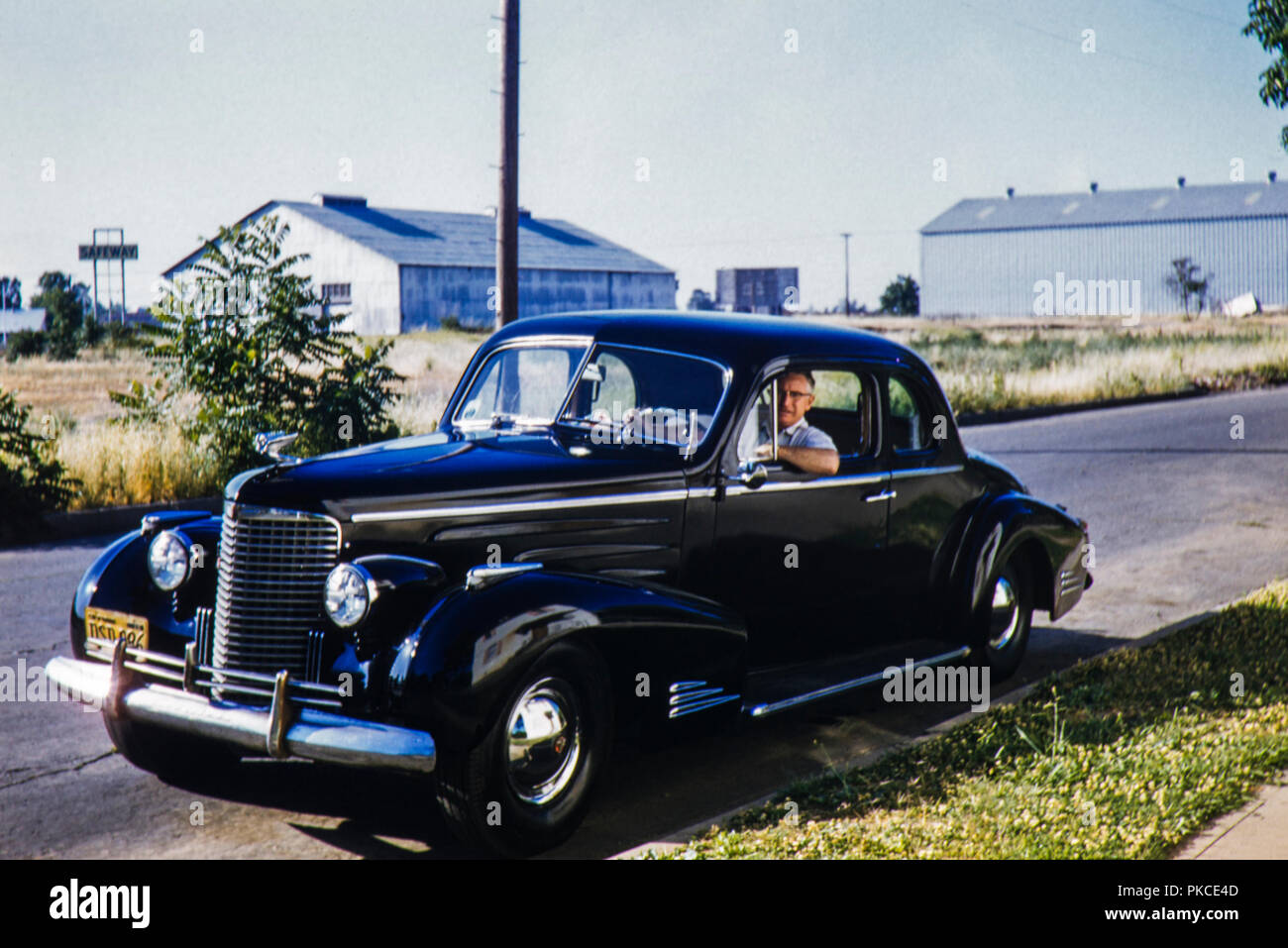 Black and chrome old 2 door Cadillac Sedan American car with a 1956