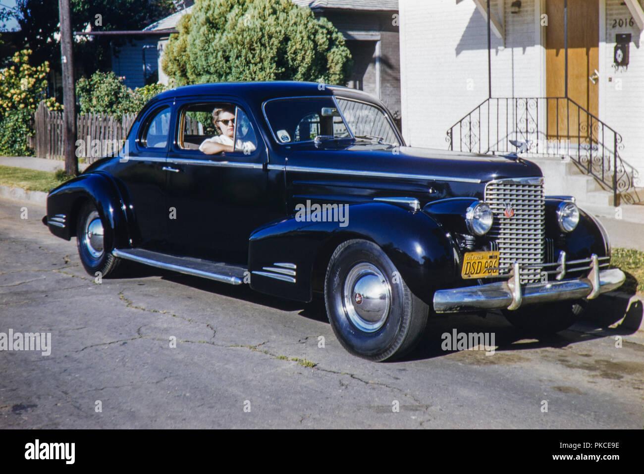 Black and chrome old 2 door Cadillac Sedan American car with a 1956