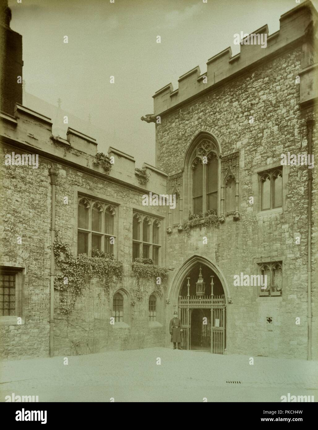 Dean's Yard, Westminster Abbey, London, 1886. Entrance to the cloisters from Dean's Yard with a policeman standing beside the gate. - Stock Image