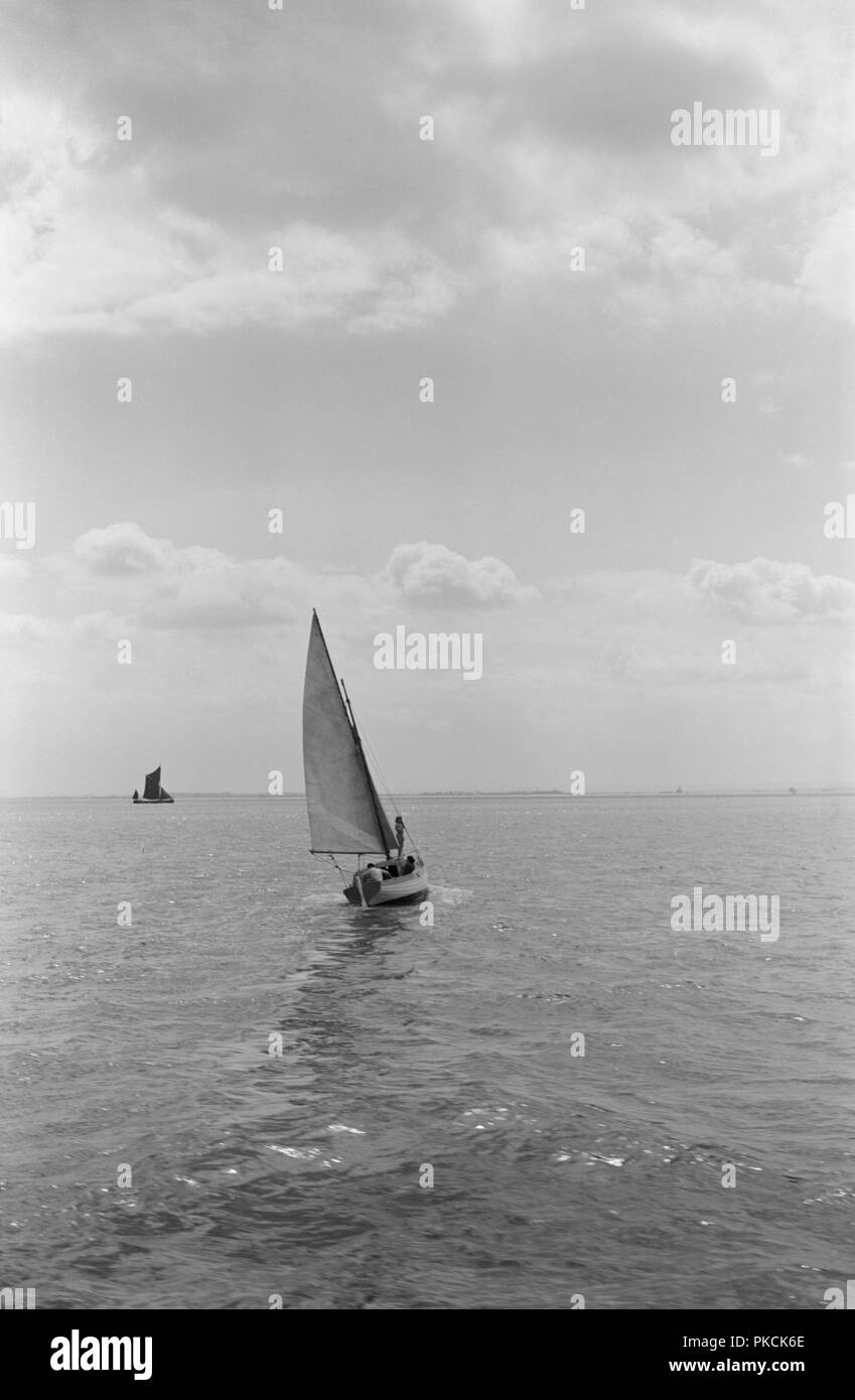 Sailing boat off Southend on Sea, Essex, c1945-c1965. A small boat turning in the wind. - Stock Image