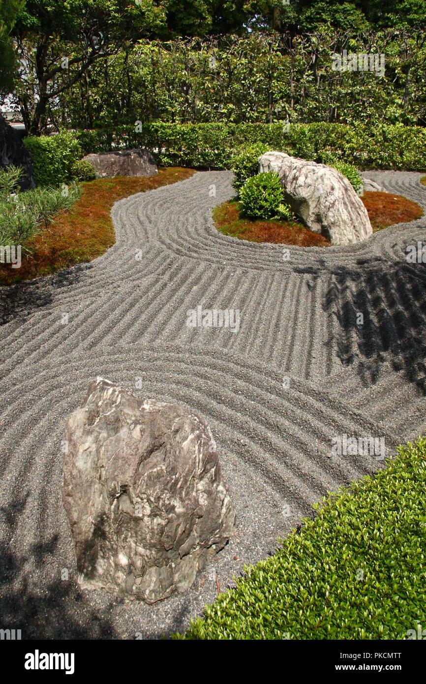 Japanese zen garden in Kyoto with big stones and raked