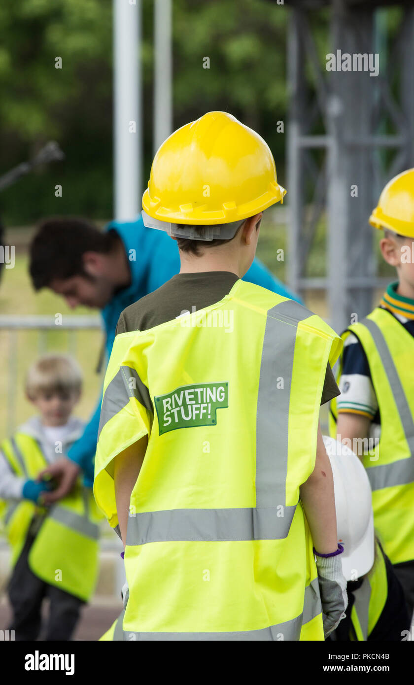 Children helping to build bridge at Institute of Civil Engineers stand at Riveting Stuff festival UK Stock Photo