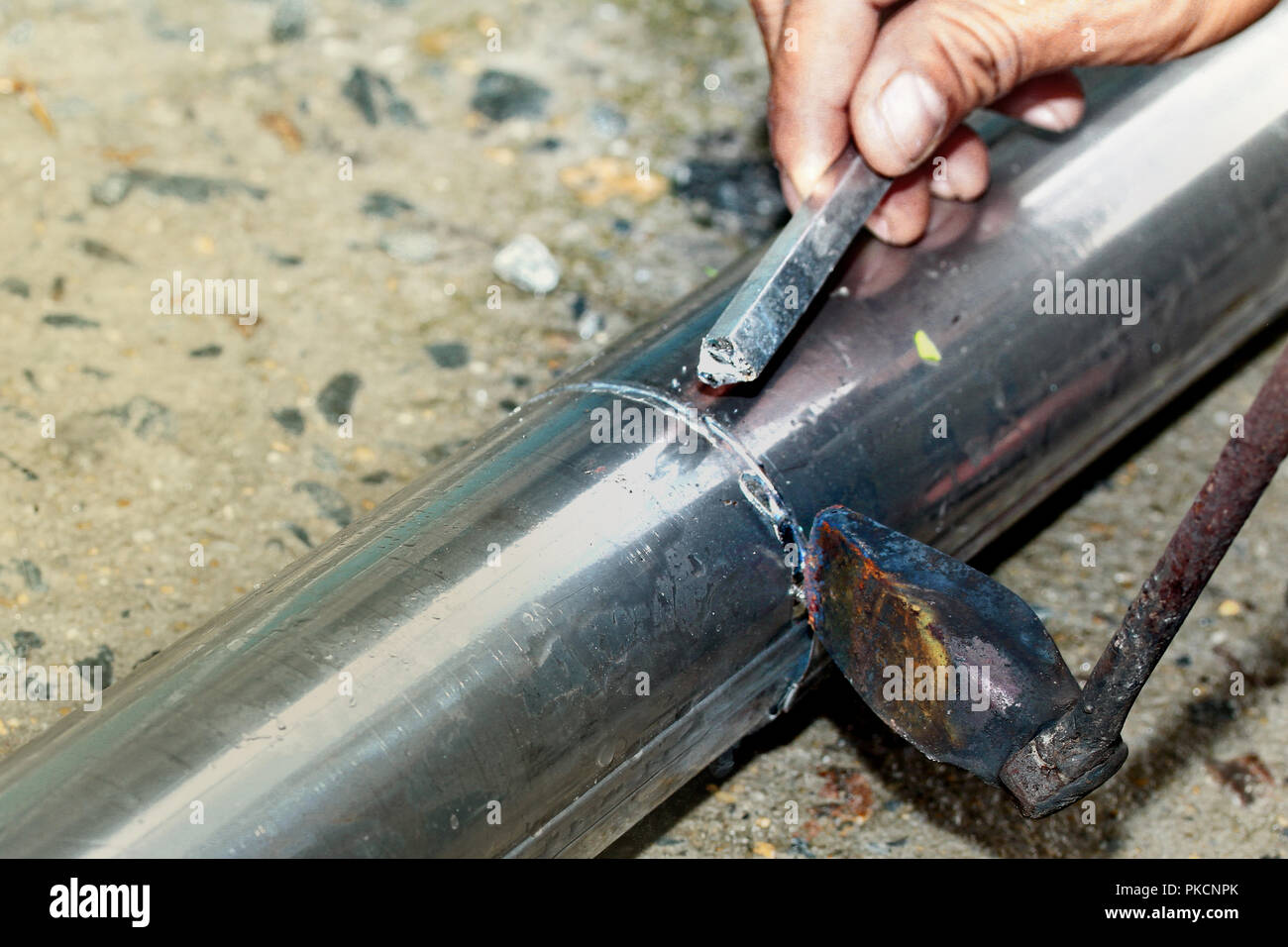 Aluminium Gutter Welding By Using Soldering Copper With Picnic Gas Technician Is Welding Aluminium Pipe By Using Soldering Copper Stock Photo Alamy