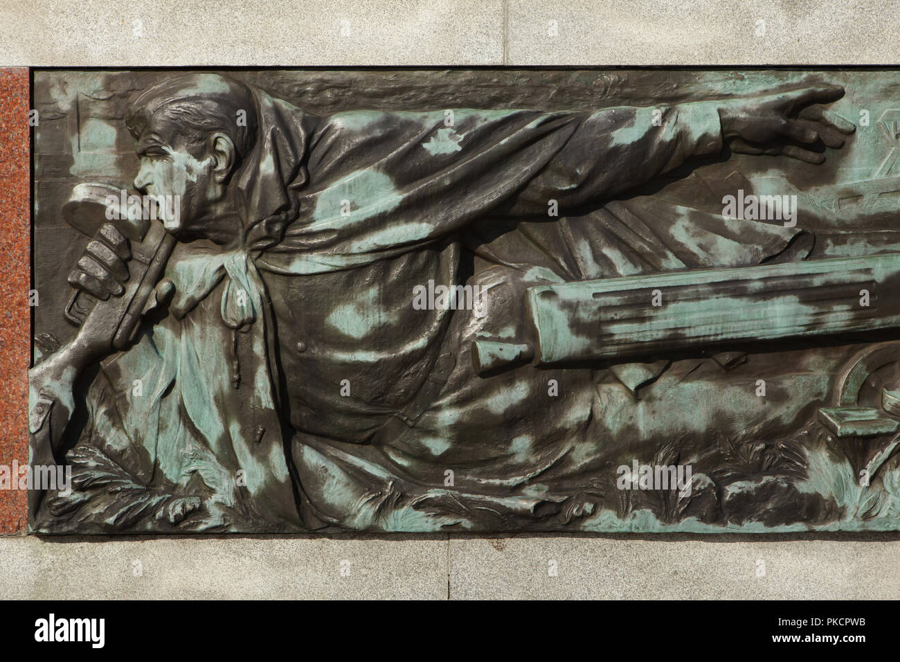 Red Army soldier depicted in the bronze relief by Czech sculptor Karel Vávra on the Red Army Memorial (Památník Rudé armády) in Ostrava, Czech Republic. The war memorial designed by Czech sculptors Karel Vávra and Konrád Babraj and Czech architect Jan Jírovec was built in 1945-1947 in the Komenského Gardens. The memorial also serves as a mausoleum for 656 Red Army soldiers fallen during the liberation of Ostrava in April 1945. - Stock Image