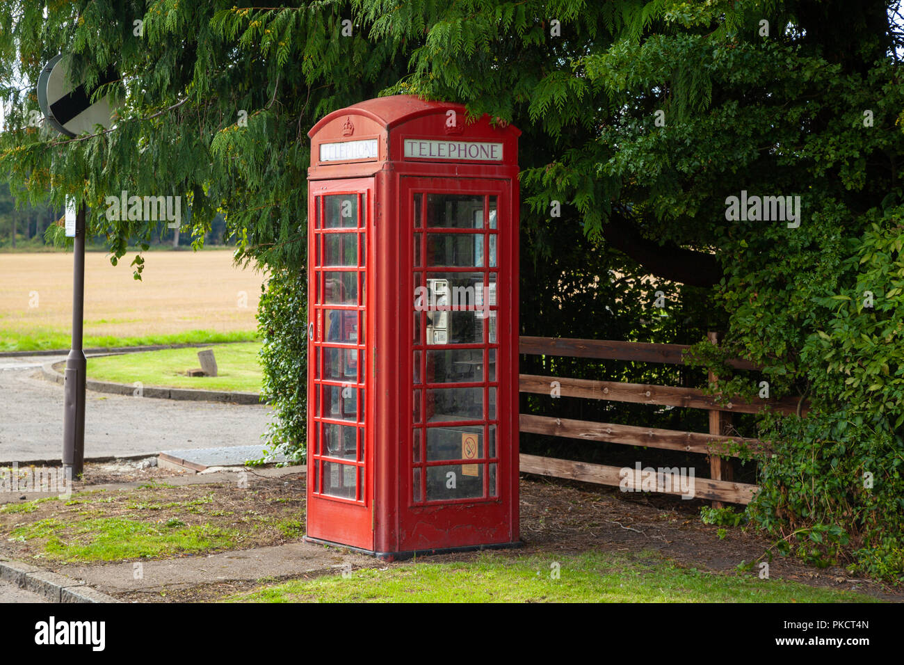 An old red British telephone box at Dunmore village near Airth Scotland. - Stock Image