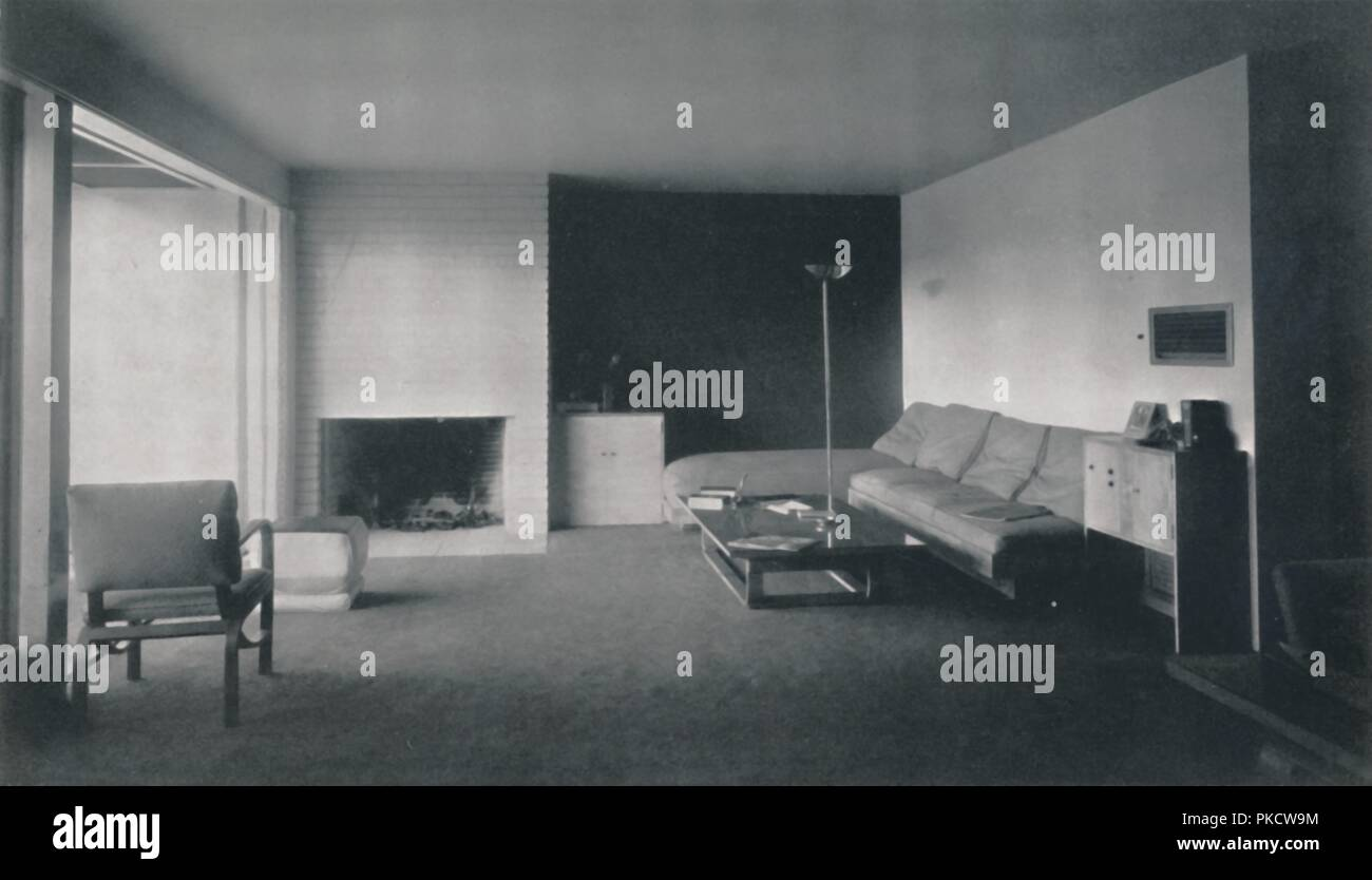 'Fireplace corner, which opens out to the patio, in the house of Mr. and Mrs. James Ward in North Hollywood, by Richard J. Neutra', 1942. House in Los Angeles, USA. From Decorative Art 1942 - The Studio Year Book, edited by C. G. Holme. [The Studio Ltd., London, 1942] - Stock Image