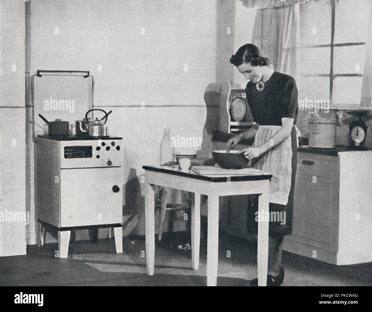 A British Kitchen Equipped With A Cabinet Gas Cooker 1942 Artist Unknown Stock Photo Alamy