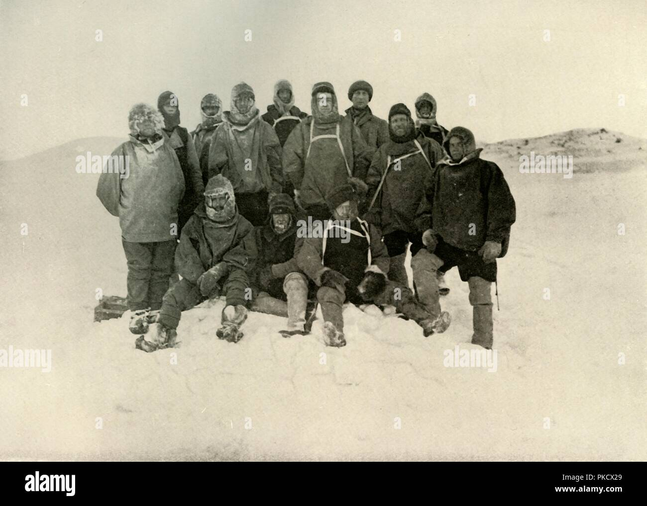 'A Group of the Shore Party at the Winter Quarters. [Standing (from left): Joyce, Day, Wild, Adams, Brocklehurst, Shackleton, Marshall, David, Armitage, Marston. Sitting: Priestley, Murray, Roberts]', c1908, (1909). Anglo-Irish explorer Ernest Shackleton (1874-1922) made three expeditions to the Antarctic. During the second expedition, 1907-1909, he and three companions established a new record, Farthest South latitude at 88°S, only 97 geographical miles (112 statute miles, or 180 km) from the South Pole, the largest advance to the pole in exploration history. Members of his team also cli - Stock Image