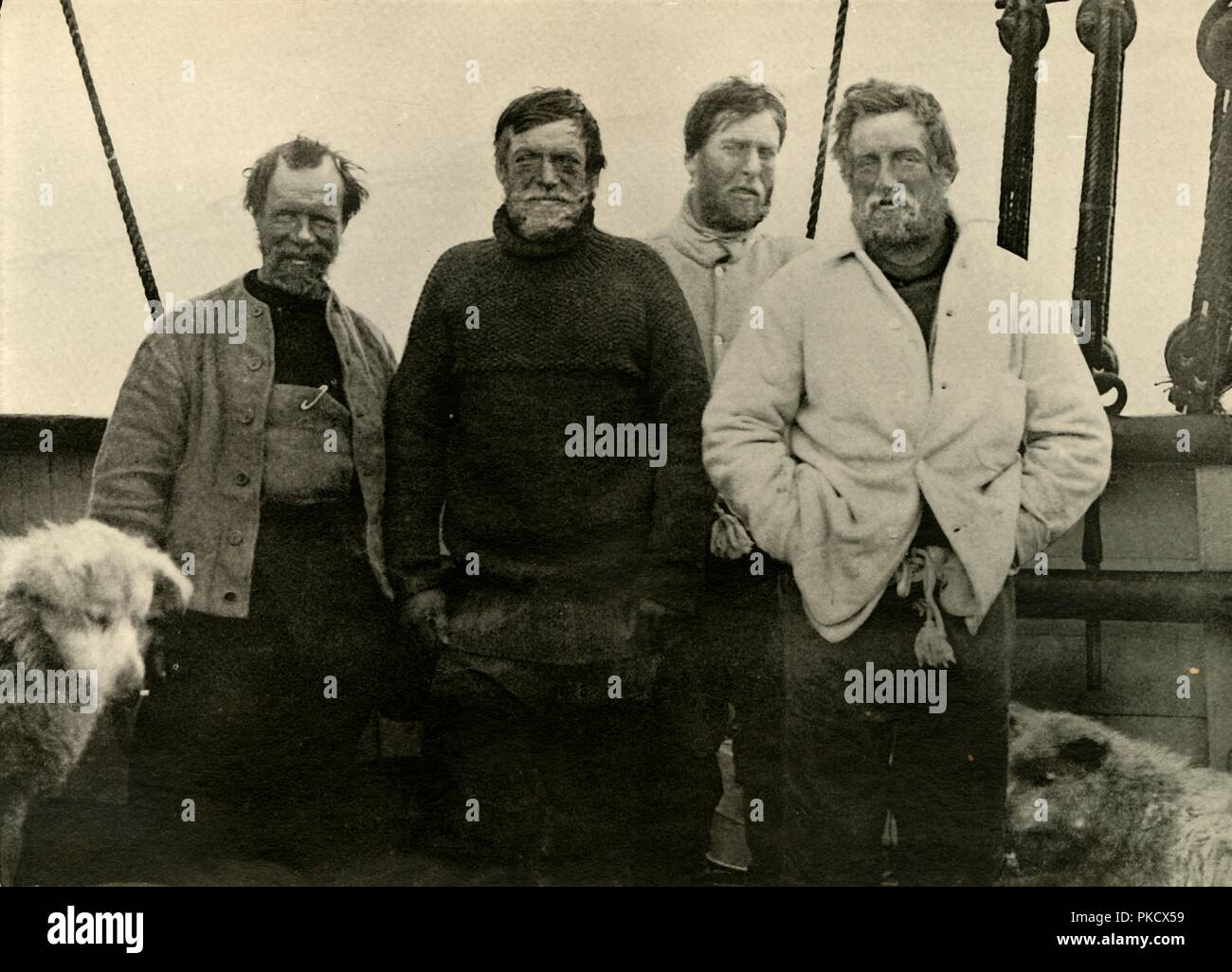 'The Southern Party on board the Nimrod.', 1909. Expedition members Frank Wild, Ernest Shackleton, Lieutenant Colonel Eric Marshall and Captain Jameson Adams. Anglo-Irish explorer Ernest Shackleton (1874-1922) made three expeditions to the Antarctic. During the second expedition, 1907-1909, he and three companions established a new record, Farthest South latitude at 88°S, only 97 geographical miles (112 statute miles, or 180 km) from the South Pole, the largest advance to the pole in exploration history. Members of his team also climbed Mount Erebus, the most active volcano in the Antarct - Stock Image