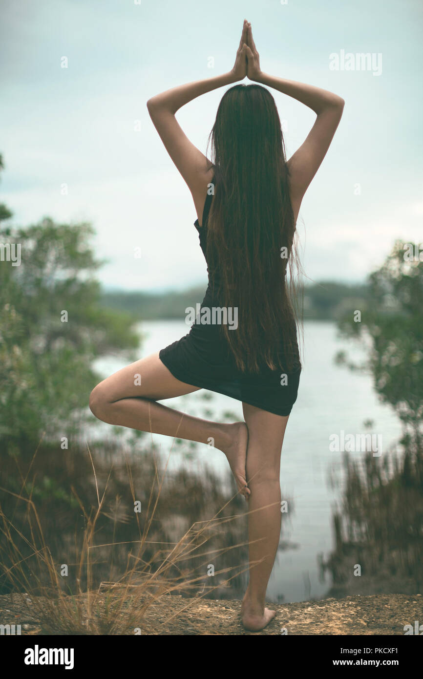 2508eb59c2 bare feet girl beauty doing yoga pose in a relaxing tranquil scene and  mood, a
