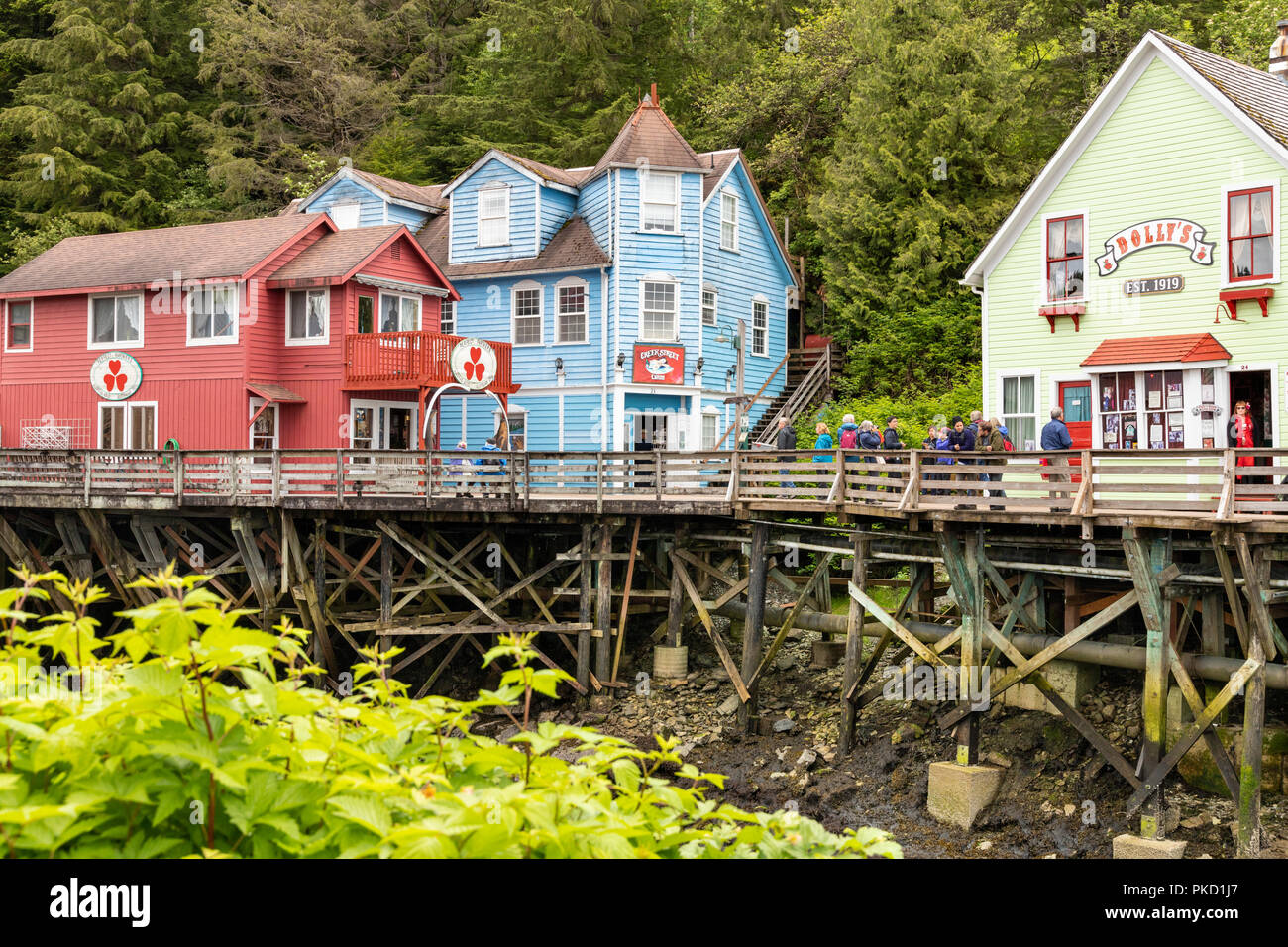Some of the old timber houses in Creek Street built on stilts above the Ketchikan Creek in downtown Ketchikan, Alaska USA - Stock Image