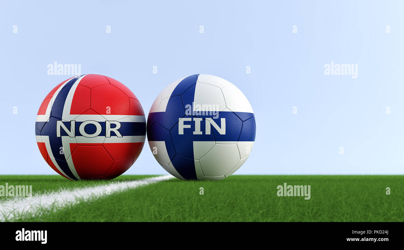 Finland vs. Norway Soccer Match - Soccer balls in Finland and Norway national colors on a soccer field. Copy space on the right side - Stock Image