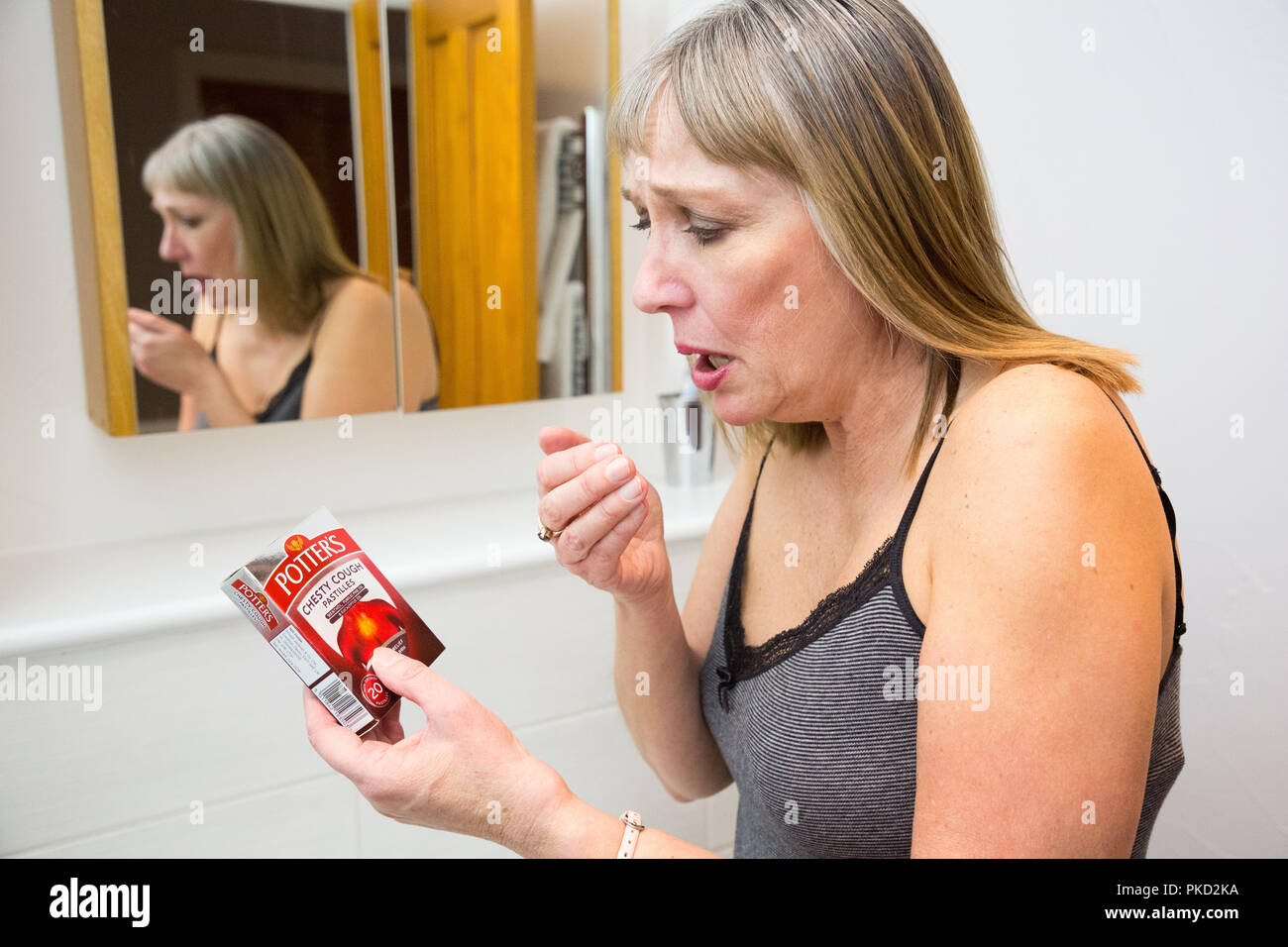 Woman coughing using Potter's cough medication - Stock Image