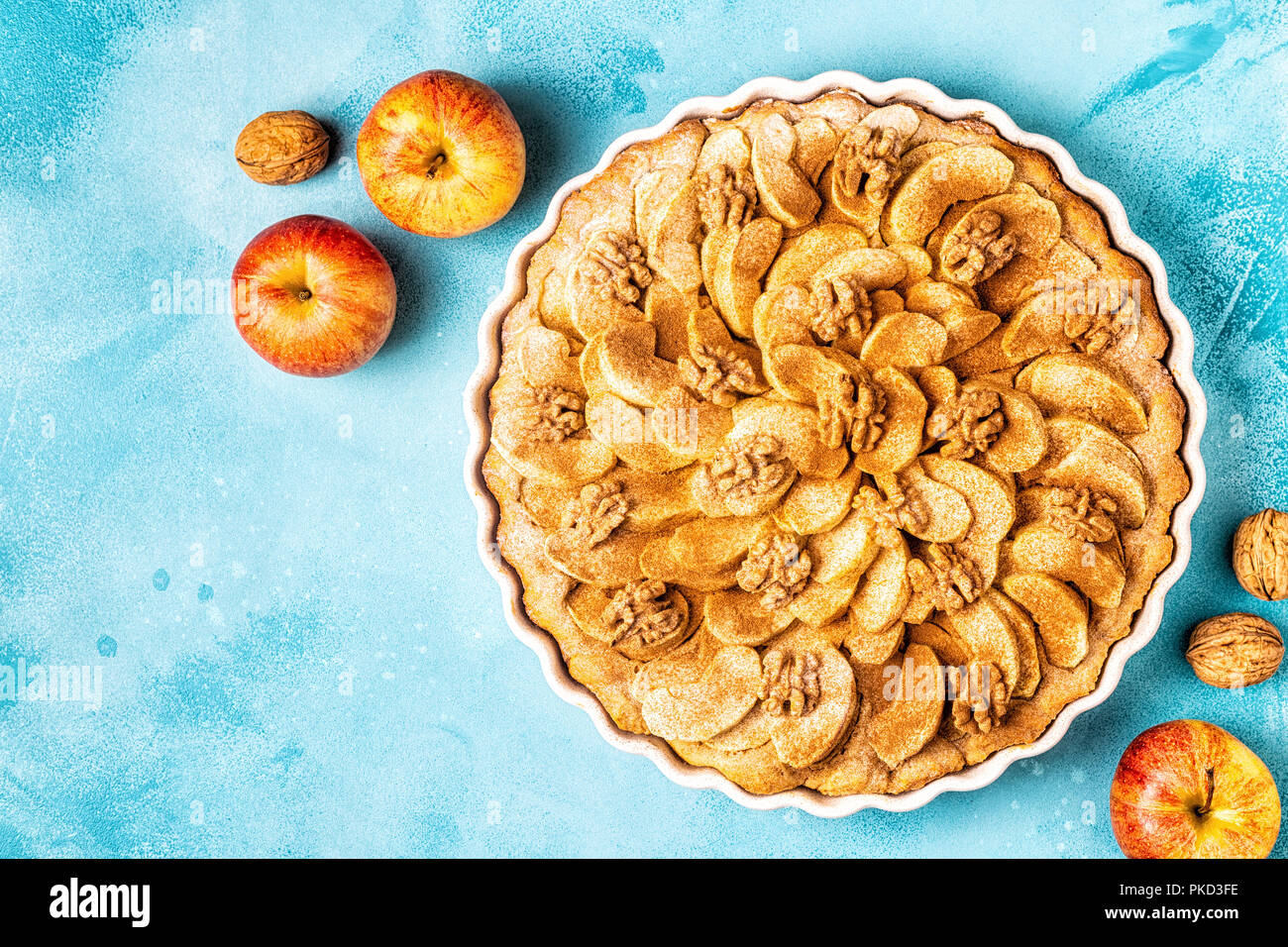 Apple pie with walnuts and cinnamon, top view. - Stock Image