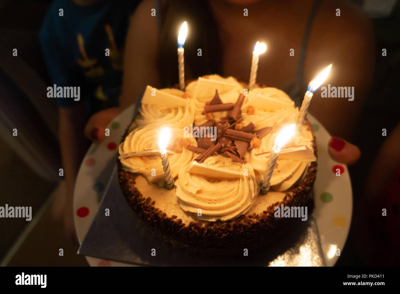 A Close Up View Of Chocolate Birthday Cake Which Has Candles Burning On Top