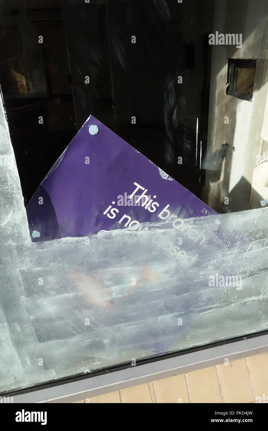 Closeup of Bank closure signs in ex bank window at a Nat West Bank Closed in Dinnington, South Yorkshire - Stock Image