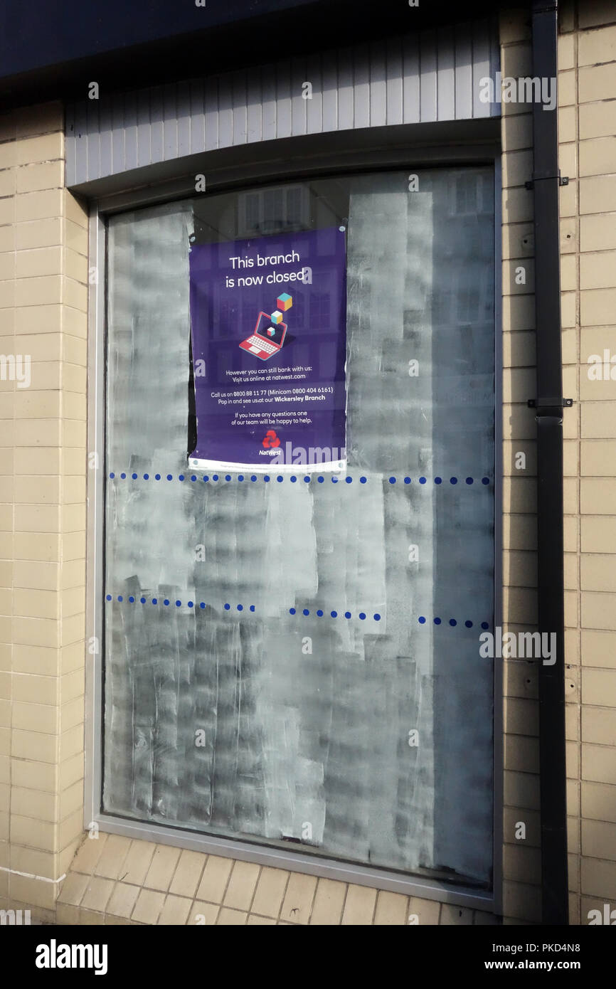 Bank closure signs in ex bank window at a Nat West Bank Closed in Dinnington, South Yorkshire - Stock Image
