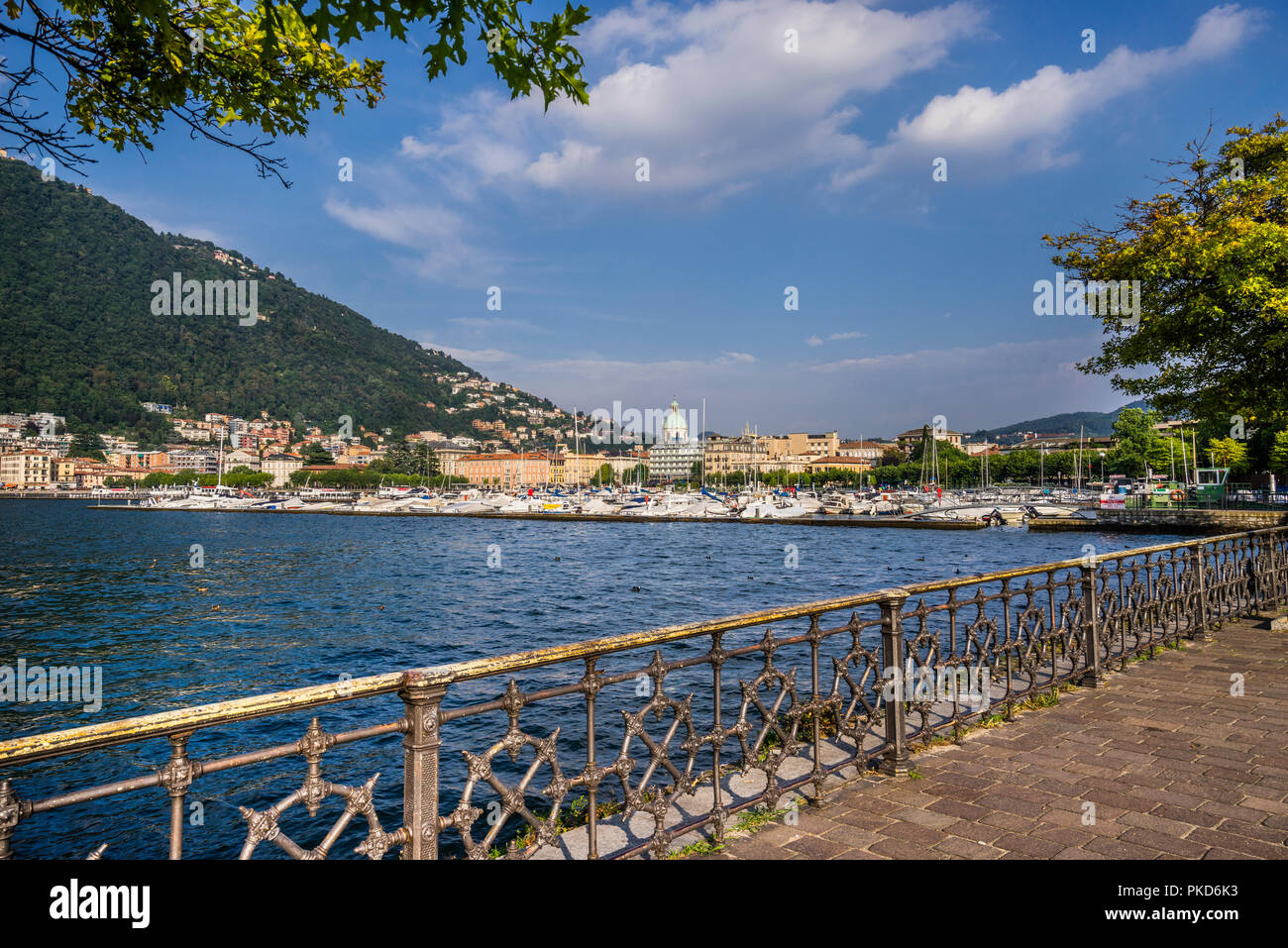 Lake Come lakefront promenade with view of the city of Como, Lombardy, Italy - Stock Image