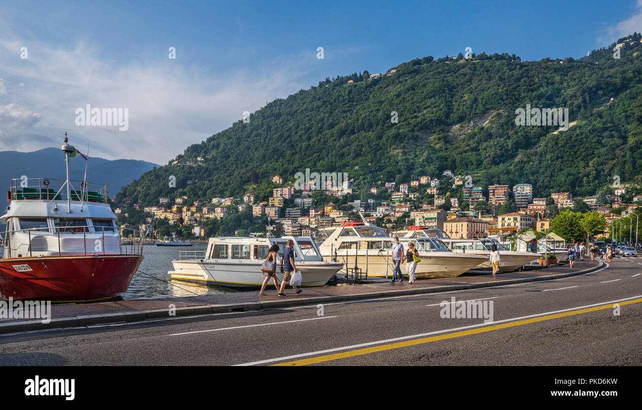 boats moored at the lakefront of Lake Como, Lungo Lario Trento, Como, Lombardy, Italy - Stock Image