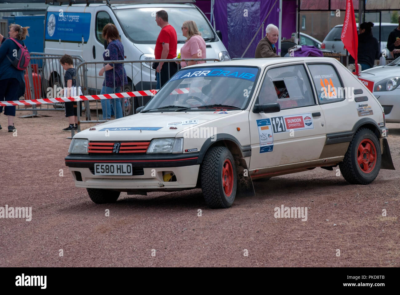The 1988 White Peugeut 205 of Jamie Stewart Argyll Rally Dunoon 2018 front left nearside passenger side view of white rally prepared sports saloon car - Stock Image