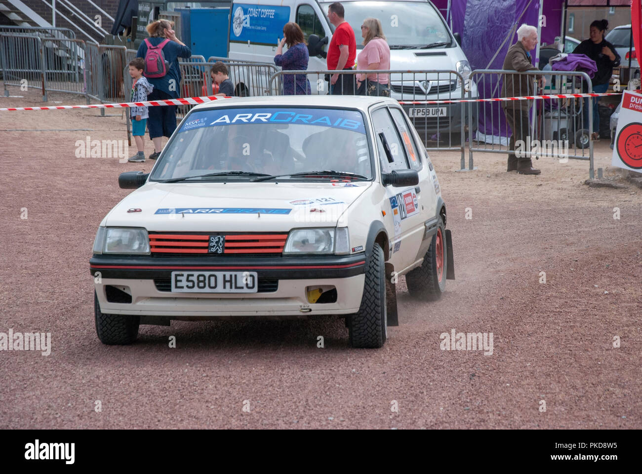 The 1988 White Peugeot 205 of Jamie Stewart Argyll Rally Dunoon 2018 front left nearside passenger side view of white rally prepared sports saloon car - Stock Image