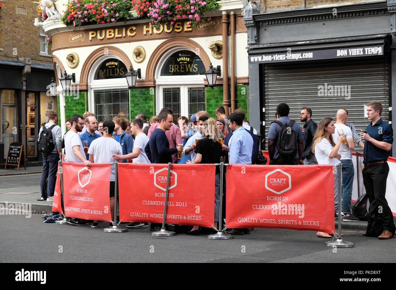 People drinking outside Craft Beer Company after work in summer in Leather Lane, Clerkenwell London EC1  KATHY DEWITT - Stock Image