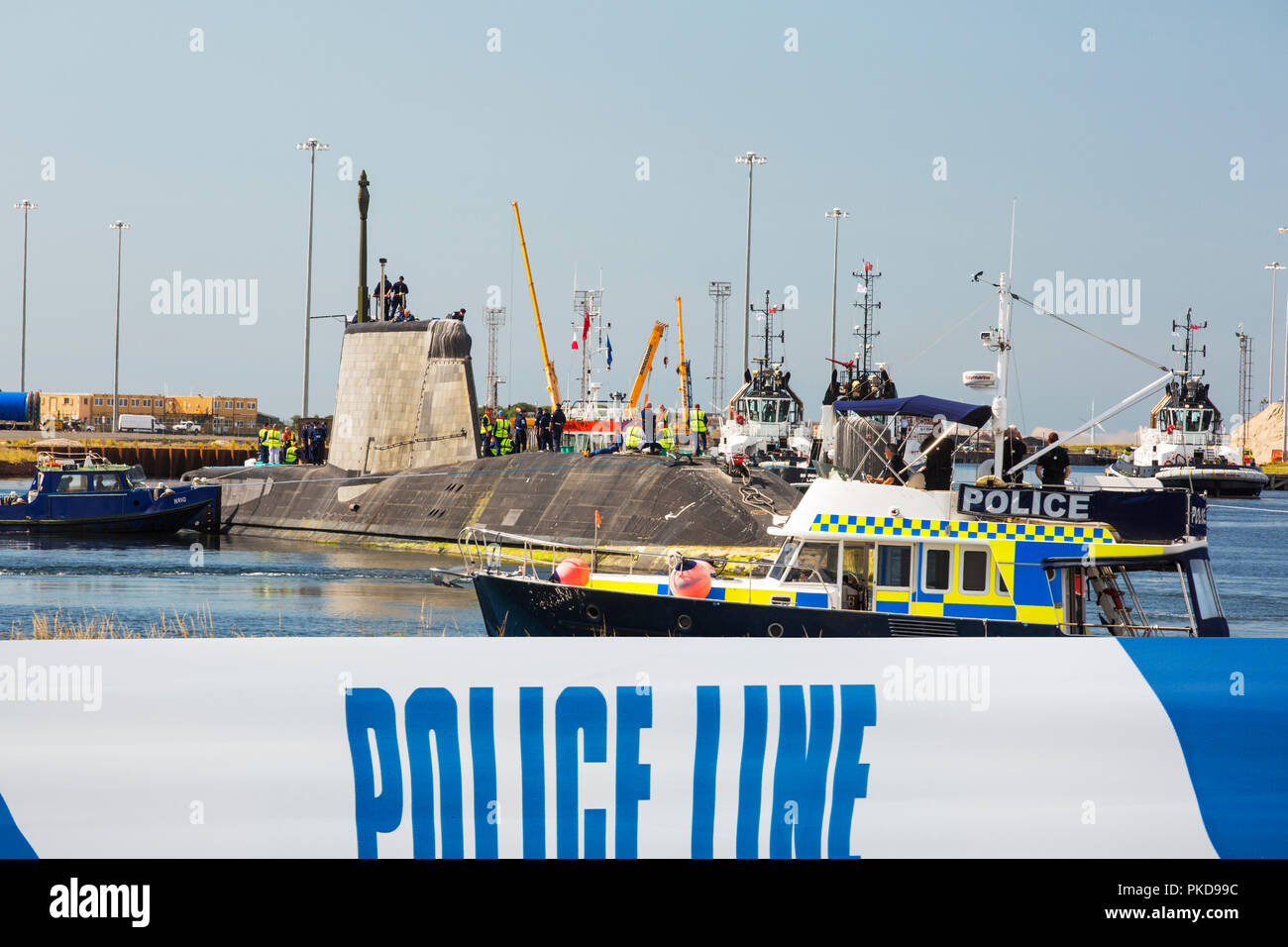 The Artful, an Astute class hunter killer nuclear powered submarine is moved from BAE Systems in Barrow in Furness up to the Faslane submarine base in - Stock Image