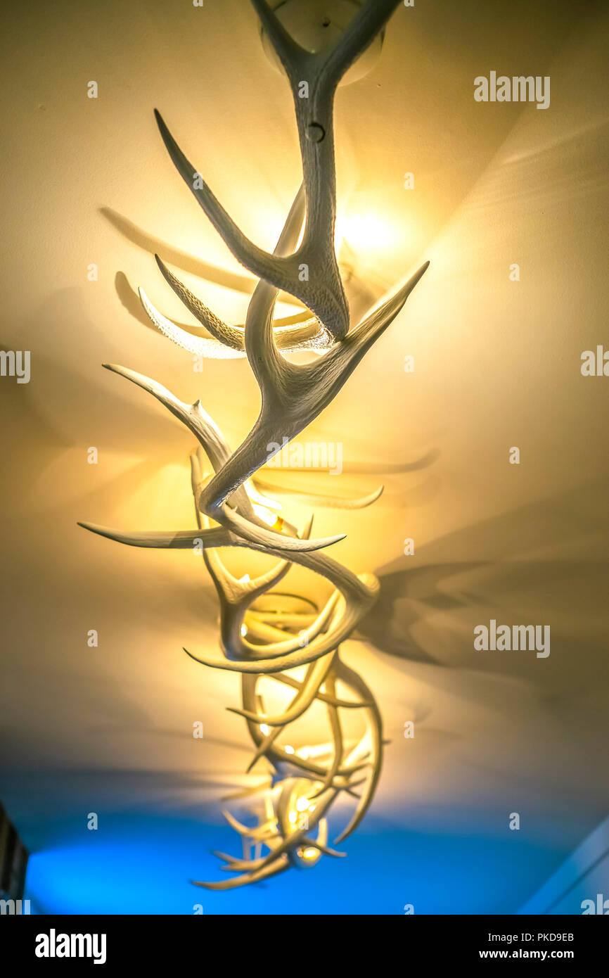 Antler deer light fixture in hotel lobby hallway - Stock Image
