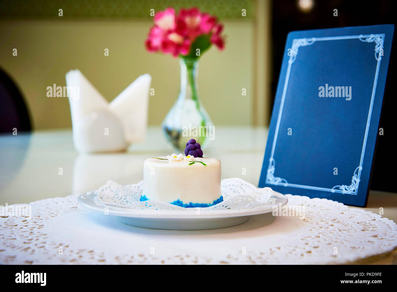 a confectionery product on a white plate with lace stands on a table