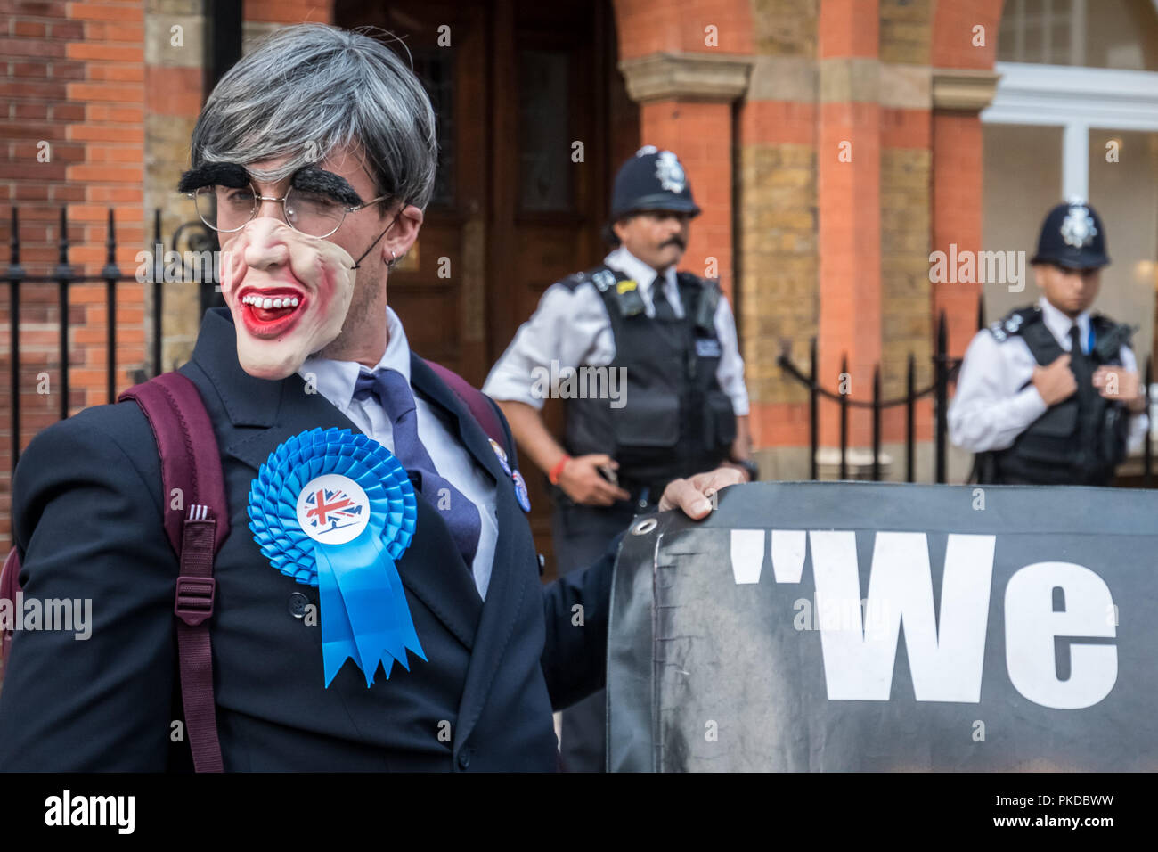 Jacob Rees-Mogg and his family are confronted by anti-capitalist protesters from Class War activist group outside his Westminster home. London, UK. - Stock Image