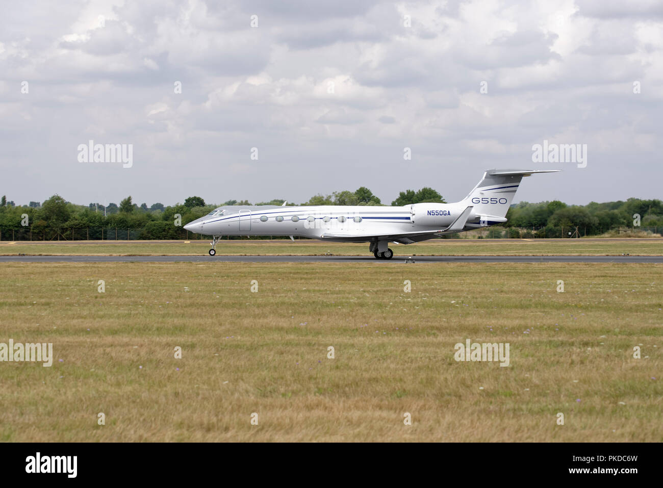 Gulfstream G550 Business Jet on its take off run to depart RAF Fairford in the United Kingdom where it was participating in the RIAT airshow - Stock Image
