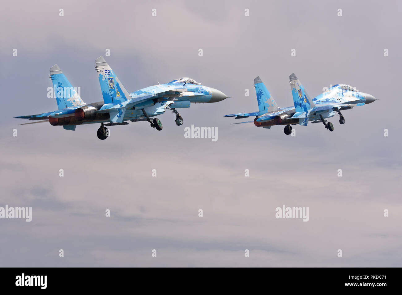 Two Ukrainian Air Force Sukhoi SU-27 air superiority jet fighters depart RAF Fairford after attending the Royal International Air Tattoo - Stock Image