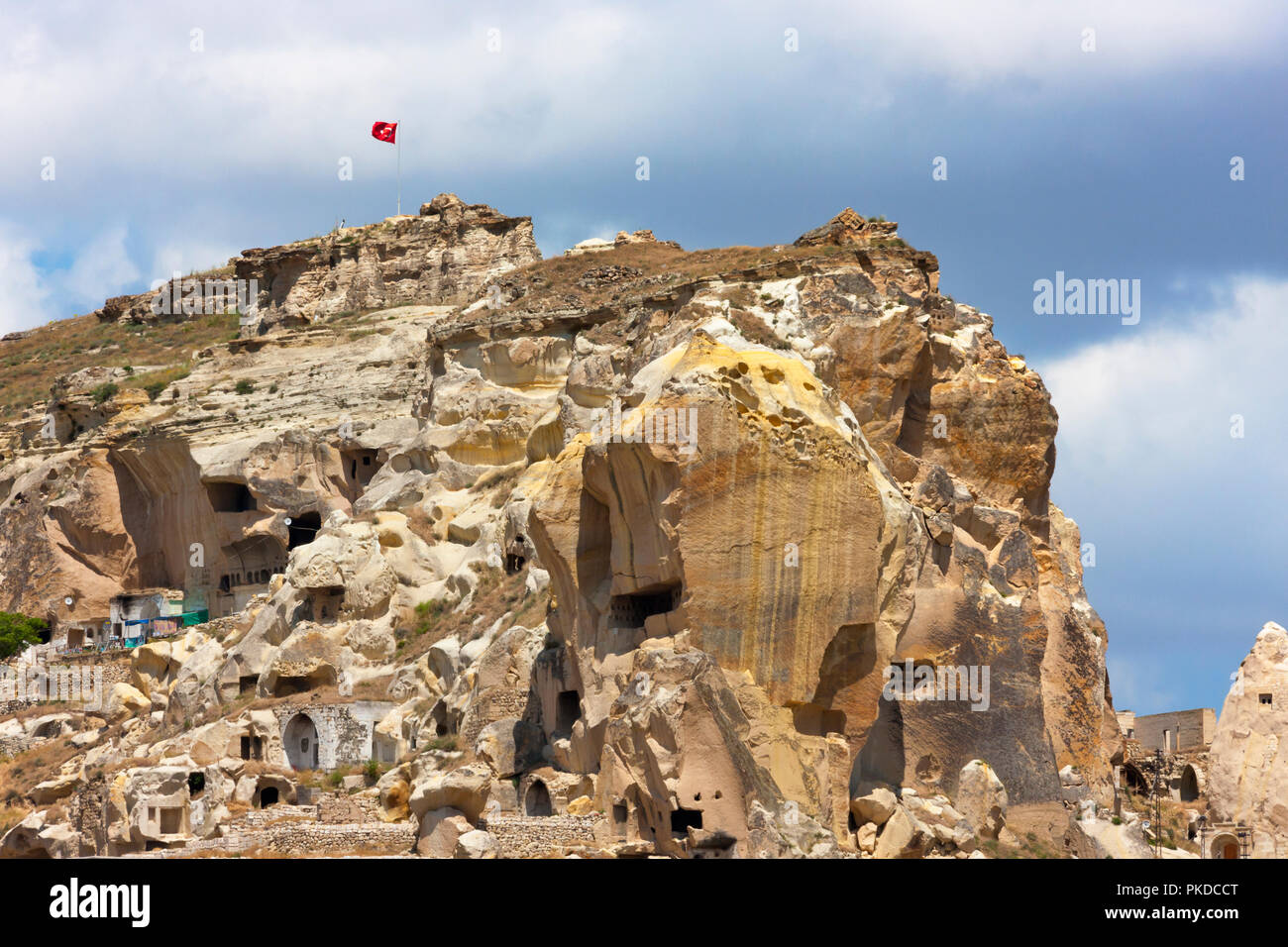Houses carved into the rocks, Nevsehir, Central Anatolia, Turkey - Stock Image